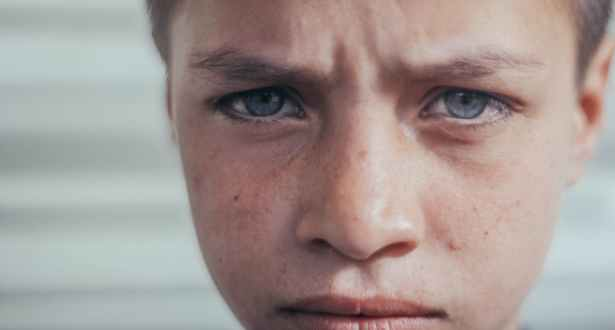 close up photo of boy s face